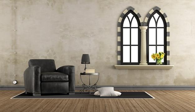 Soggiorno vintage retrò con poltrona in pelle e due finestre gotiche