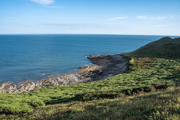 Baia di rhossili sul percorso costiero gallese, galles del sud