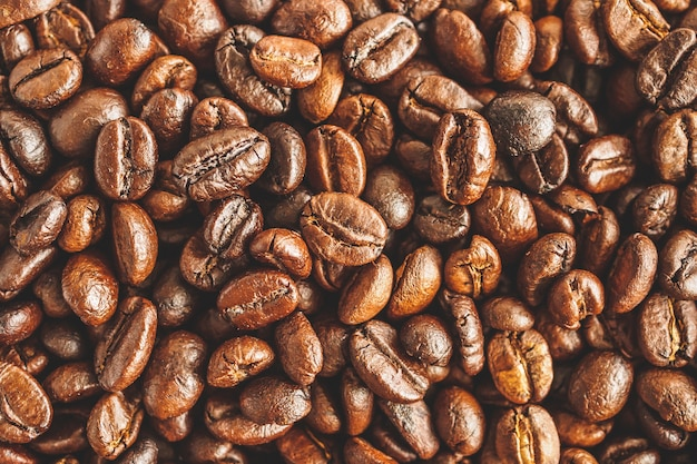 Priorità bassa di struttura del primo piano dei chicchi di caffè arrostiti
