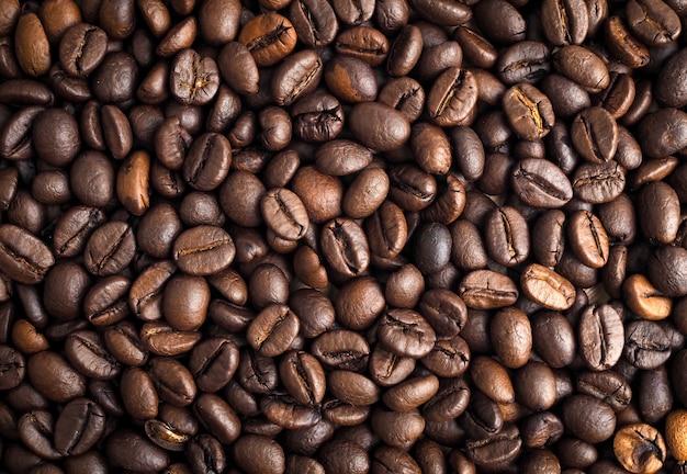 Chicchi di caffè tostati texture di sfondo, vista dall'alto