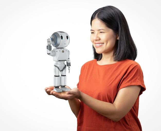 Il concetto di assistente del robot con la donna asiatica tiene il robot della rappresentazione 3d