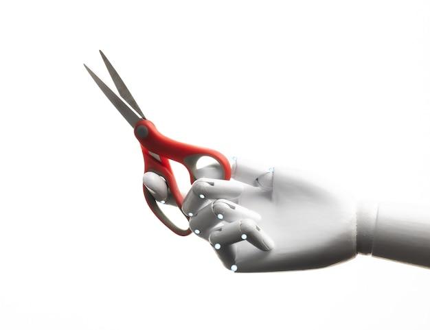 Robot tenere in mano un paio di forbici isolato su bianco