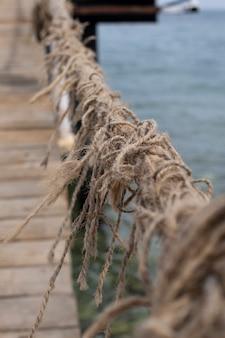 Corda fatta di fili. immagine di sfondo della corda. mare ãƒâƒã'â¢ãƒâ'ã'â€ãƒâ'ã'â‹ãƒâƒã'â¢ãƒâ'ã'â€ãƒâ'ã'â‹e nodo.