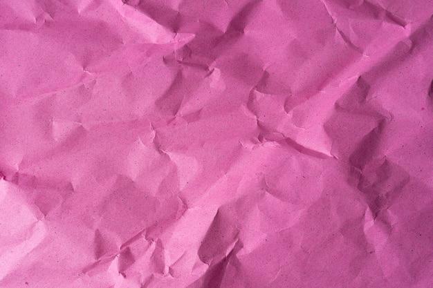 Vista dall'alto di texture di carta stropicciata rosa, il modello può essere utilizzato per lo sfondo del testo o di qualsiasi contenuto. sfondo di carta in alta risoluzione