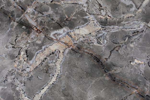 Trama di marmo grigio ruvido con striature