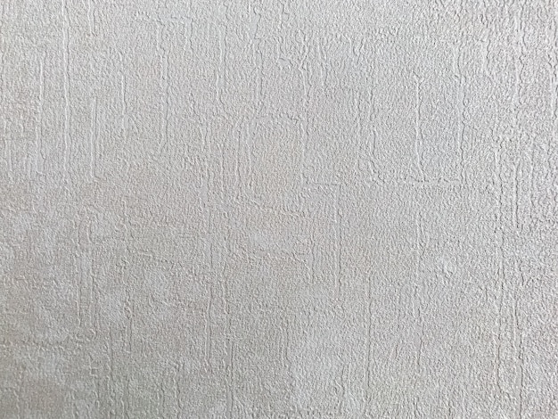 La trama ruvida del tessuto su sfondo di carta grigia viene utilizzata per il design della carta da parati