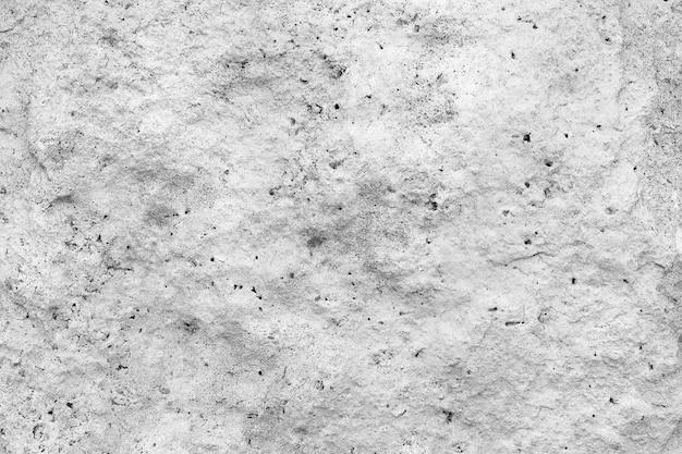 Struttura ruvida e irregolare di un primo piano grigio del muro di cemento.