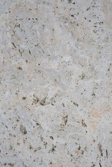 Lastra di marmo lavorata approssimativamente. vista dall'alto. sfondi e trame.