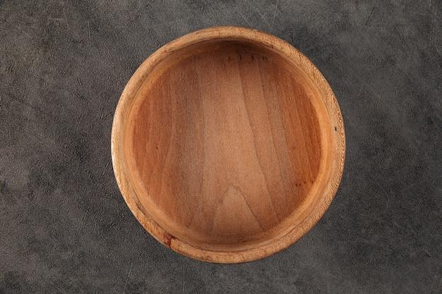 Ciotola rotonda in legno naturale vuota marrone