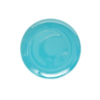 Piatto rotondo in ceramica isolato su sfondo bianco. disposizione piatta, vista dall'alto