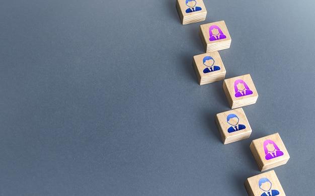Una fila di blocchi con i dipendenti reclutamento e assunzione di personale ricerca e assunzione di nuovi dipendenti