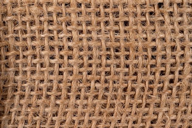 Trama rurale di tela di sacco. fondo di tessuto molto grossolano e ruvido fatto di lino, iuta o canapa
