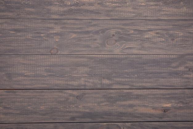 Vista superiore del tavolo in legno grigio invecchiato rustico. fondo in legno