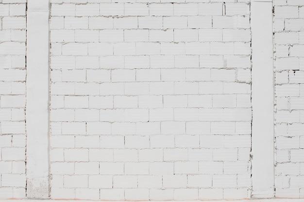 Fondo bianco rustico del muro di mattoni