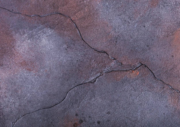 Fondo di struttura di pietra concreto del cemento porpora blu arrugginito. vista dall'alto