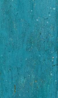 Superficie di metallo verniciato arrugginito sullo sfondo della parete. modello di materiale rustico blu grunge.