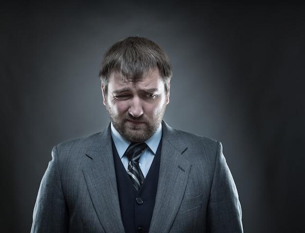 Uomo d'affari triste