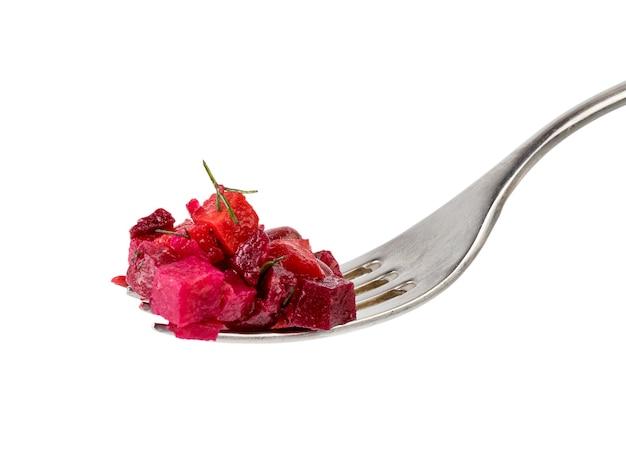 Vinaigrette dell'insalata sulla fine della forcella su isolata