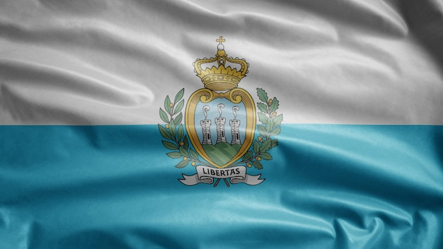 Bandiera sammarinese che sventola nel vento. soffiaggio san marino, seta morbida e liscia. ensign della trama del tessuto di stoffa