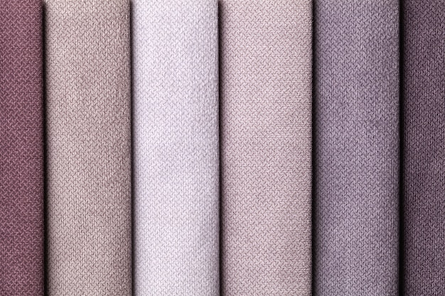 Campione di colori marrone e grigio tessile di velluto, sfondo. catalogo e tonalità di tavolozza di tessuto per interni per mobili, primo piano. collezione di stoffa multicolore.