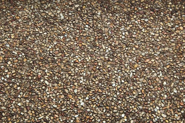 Sfondo di tecture sabbia e pietra per pavimento esterno intorno alla piscina