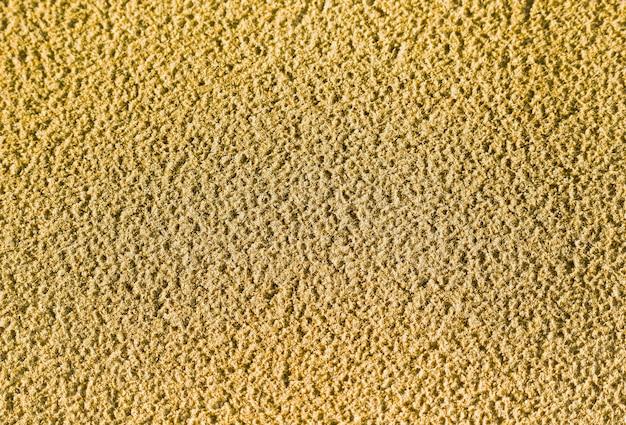 Lo sfondo della trama di sabbia con una superficie ruvida della spiaggia tropicale in thailandia