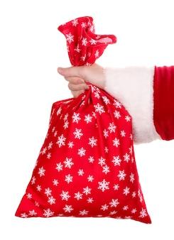 Santa claus mano che tiene il sacchetto dei regali isolato su bianco