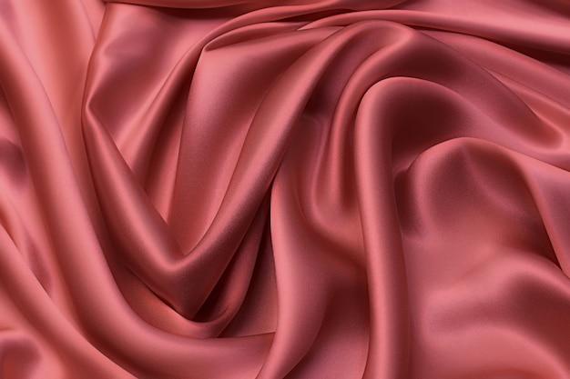 Tessuto di seta satinato in colore beige-rosa in layout artistico