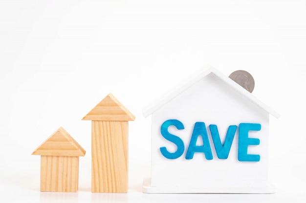 Salvare la parola sulla casa è bianco salvadanaio