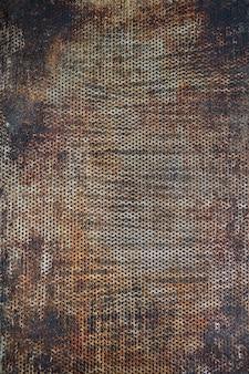 Superficie astratta graffiata della vecchia teglia da forno come sfondo. può essere utilizzato per la tua creatività.