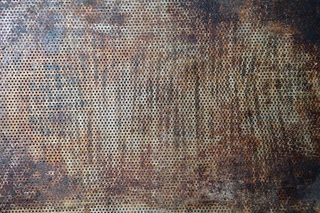 Fondo graffiato di una vecchia teglia da forno come sfondo creativo. copia spazio.