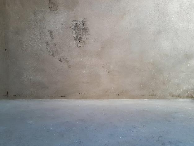 Sfondo di muro di pietra grigio graffiato