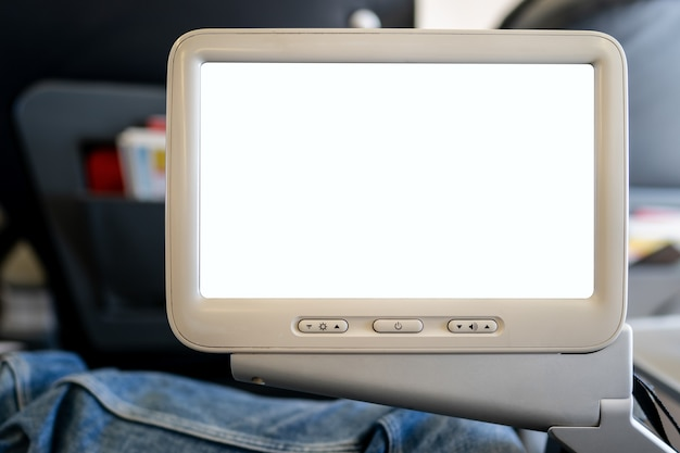 Schermo in aereo, display bianco vuoto in volo.