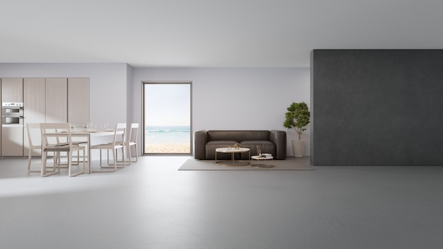 Cucina vista mare, sala da pranzo e soggiorno di casa sulla spiaggia di lusso dal design moderno.