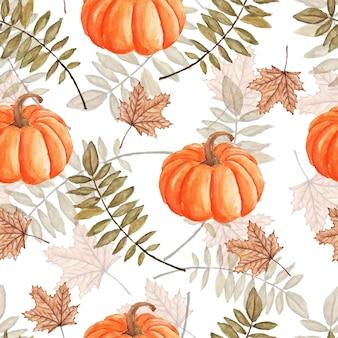 Seamless pattern autunnale di foglie zucche e foglie di acero acquerello dipinto su bianco