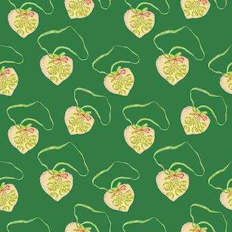 Motivo natalizio senza cuciture dalla morbida decorazione dell'albero di natale ricamato a forma di cuore isolato su verde chiaro, stampa per carta, tessuto, carta da parati.