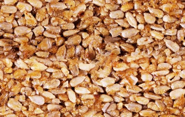 Kozinaki senza cuciture da fagioli di arachidi tostati dorati come trama di sfondo