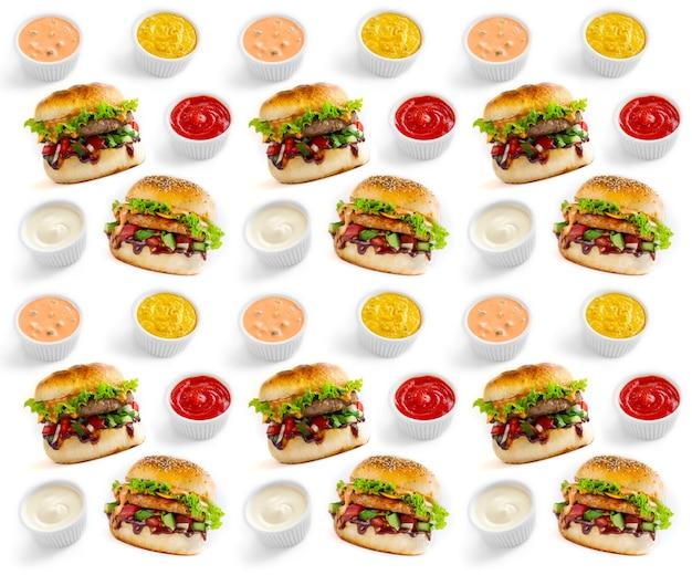 Modello senza cuciture di hamburger e salse su sfondo bianco
