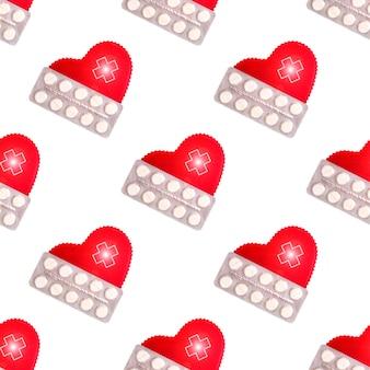 Modello senza cuciture di cuore decorativo e pillole. concetto di cuore sano vista dall'alto piatto disteso.