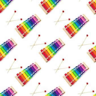 Modello senza giunture di arcobaleno colorato giocattolo di legno 8 tono xilofono glockenspiel isolato su bianco backg