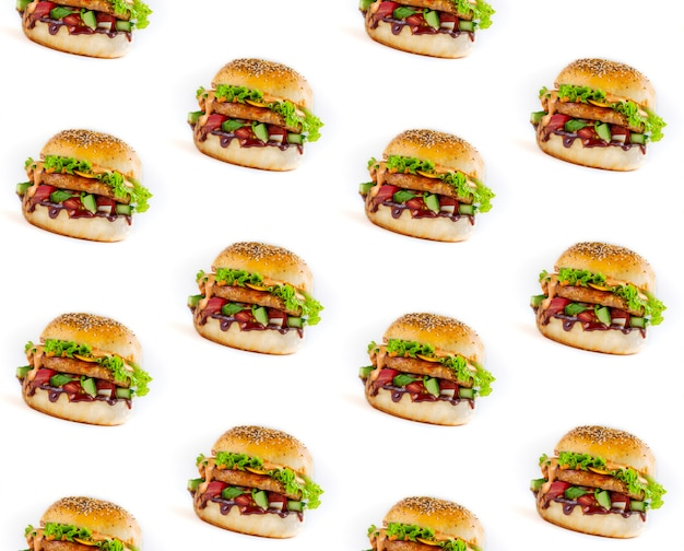 Modello senza cuciture di gustoso hamburger su sfondo bianco
