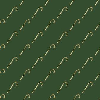 Modello senza cuciture con bastoncini di zucchero di natale su sfondo verde, vista dall'alto. può essere usato come elementi decorativi per natale e capodanno, carta da regalo, elementi tessili