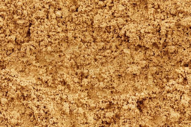 Sabbia senza soluzione di continuità su un intero sfondo