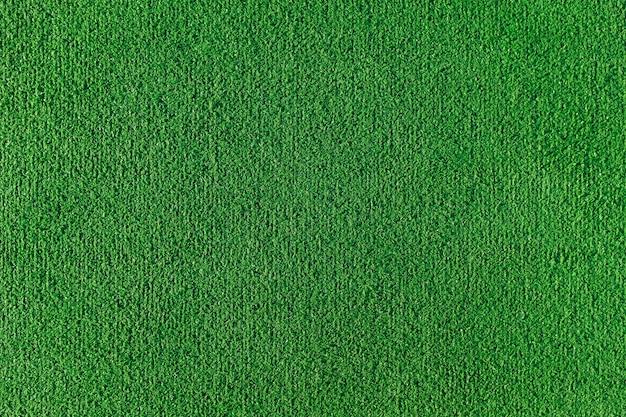 Struttura senza giunte del campo di erba artificiale. trama verde di un campo di calcio, pallavolo e basket