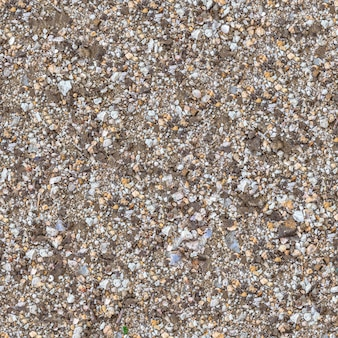 Seamless texture di frammento di terreno mescolato con ghiaia, macadam, pezzi di coquina e vetro.
