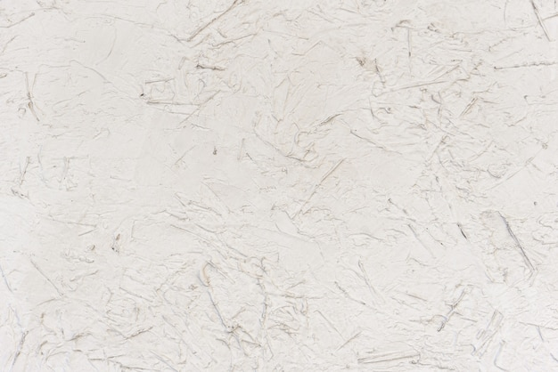 Trame senza soluzione di continuità di pannelli truciolari dipinti con vernice bianca
