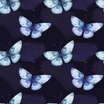 Modello acquerello senza soluzione di continuità con grandi farfalle astratte blu su sfondo blu