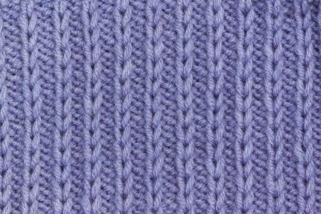 Priorità bassa di struttura del tessuto di maglieria lilla senza cuciture.