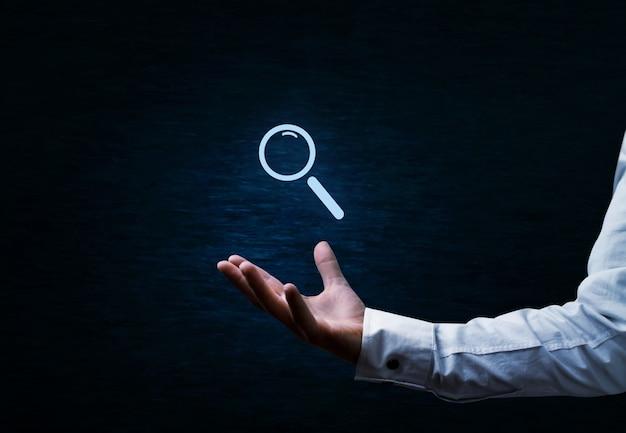 Simbolo di ricerca e seo su sfondo blu scuro dark