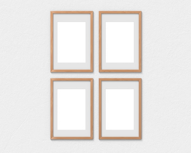 Set di 4 mockup di cornici verticali in legno con un bordo appeso al muro